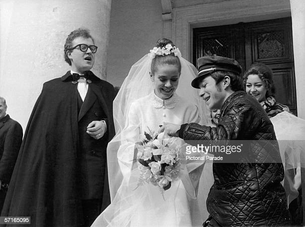 A telegram deliverer delivers a telegram to newly married French poetess Minou Drouet as her new husband singer and actor Patrick Font stands next to...