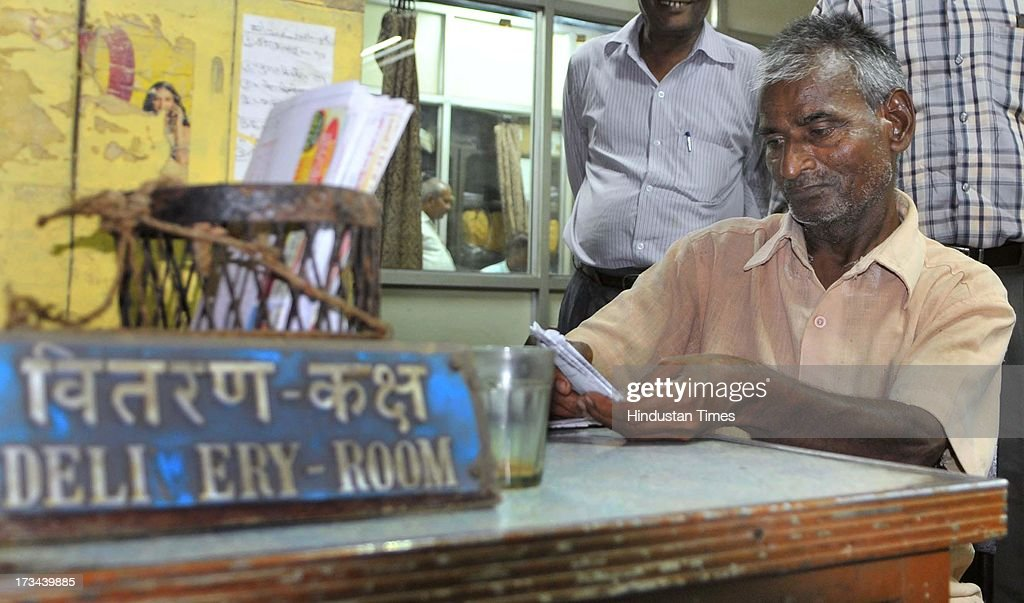 Telegram Delivery man Rambabu assorts the last bundle of telegrams he has to deliver, at General Post Office on July 14, 2013 in Jaipur, India. The work to lay telegraph lines started in 1850 on an experimental basis between Koklata and Diamond Harbour, it was opened for use by the British East India Company the following year. In 1854, the service was made available to the public. 163-year-old telegram service is being shut down by the Government from 15th of July, across the country.