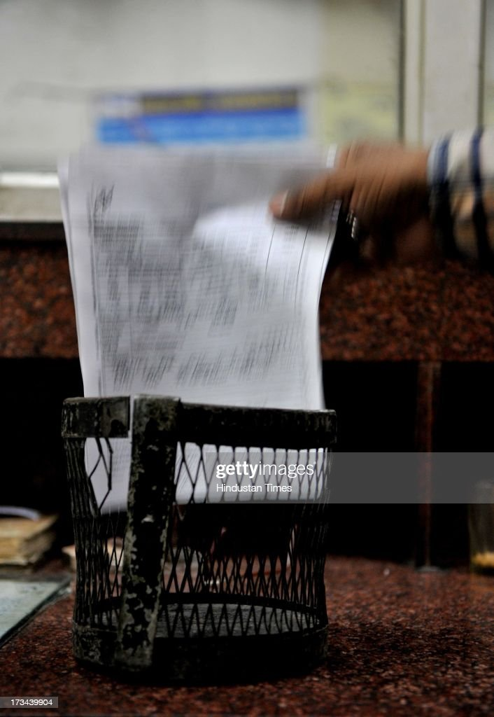 A telegram department official takes out the last bundle of telegrams from counter, at General Post Office on July 14, 2013 in Jaipur, India. The work to lay telegraph lines started in 1850 on an experimental basis between Koklata and Diamond Harbour, it was opened for use by the British East India Company the following year. In 1854, the service was made available to the public. 163-year-old telegram service is being shut down by the Government from 15th of July, across the country.