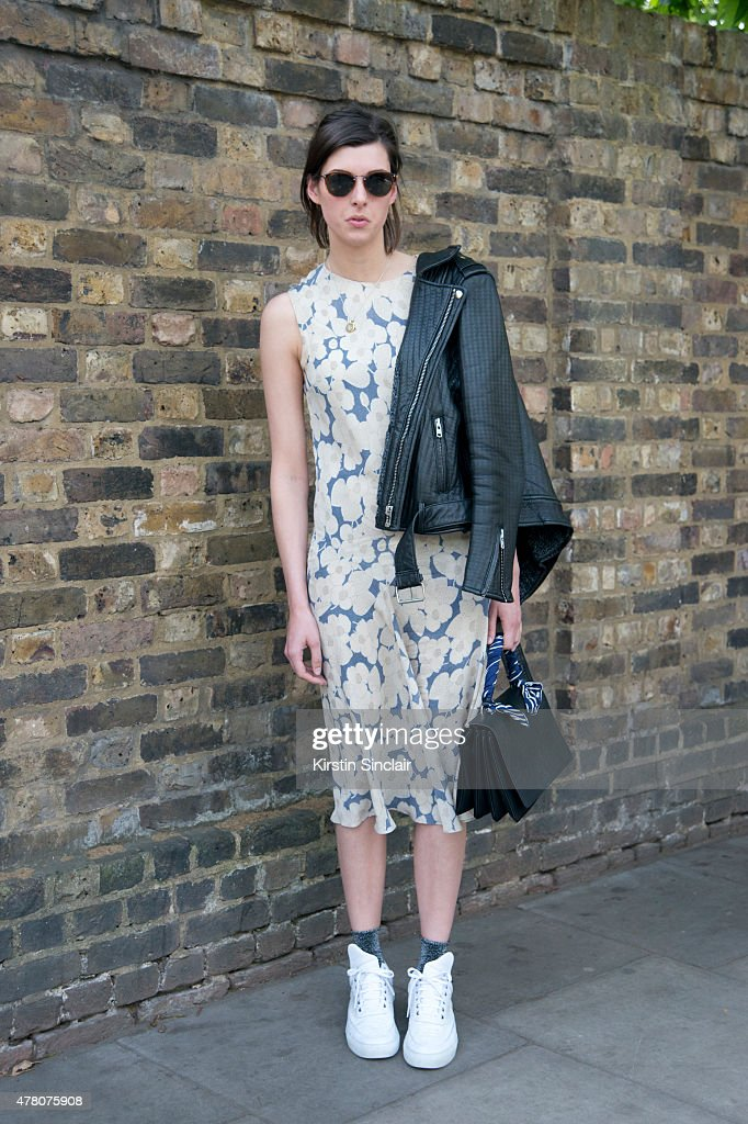 Telegraph stylist and shopping editor Sophie Warbuton wears Joseph dress Maje jacket Prada bag and Calvin Klein sunglasses on day 4 of London...