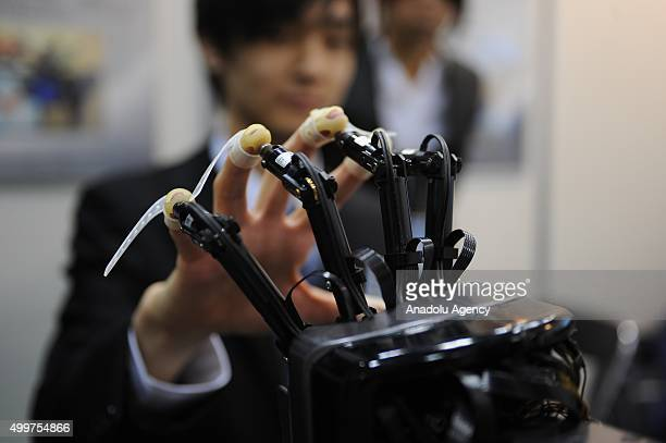 A telemanipulation for humanoid robot hand is seen during the international Robot exhibition 2015 at Tokyo Big Sight Japan on December 3 2015