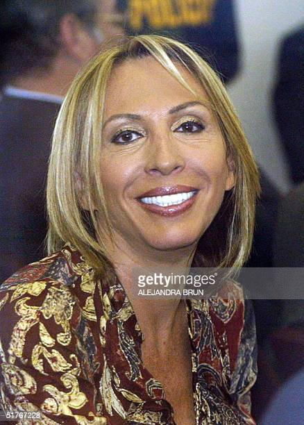 Telemundo anchorwoman Laura Bozzo smiles to the press moments before her trial on charges for embezzlement and illicit association to break the law...