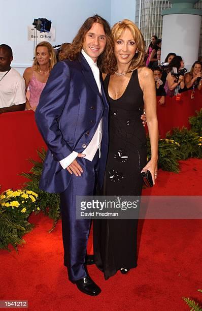 Telemundo talk show host Laura Bozzo and her boyfriend Cristian Zuarez attend the Billboard Latin Music Awards May 9 2002 at the Jackie Gleason...