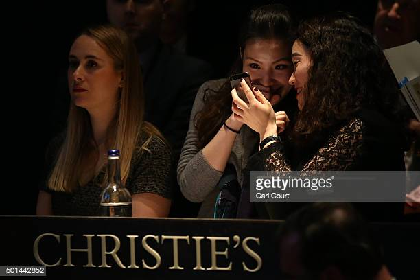 Telephone bidders share a joke during an auction for items belonging to late British Prime Minister Margaret Thatcher at Christies on December 15...