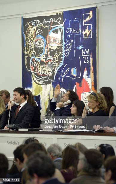 Telephone bidders sit in front of JeanMichel Basquiat's 'Untitled' during the Sotheby's London Evening Sale of Contemporary Art held at Sotheby's New...