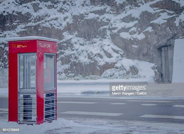 Telephone Booth On Street With Snow During Winter