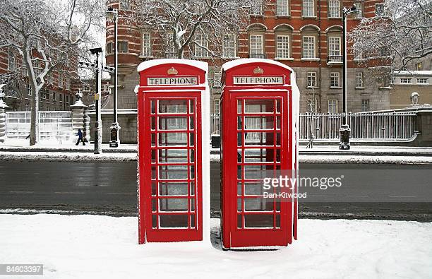 Telephone boxes stand in snow after a night of heavy snow on February 2 2009 in London England Heavy snow has fallen across parts of England leading...
