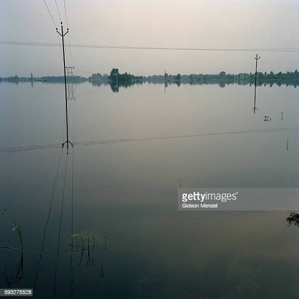 Telephone lines are reflected in the floodwaters which have submerged farmland near Muzaffarpur This is in the province of Bihar which was devastated...