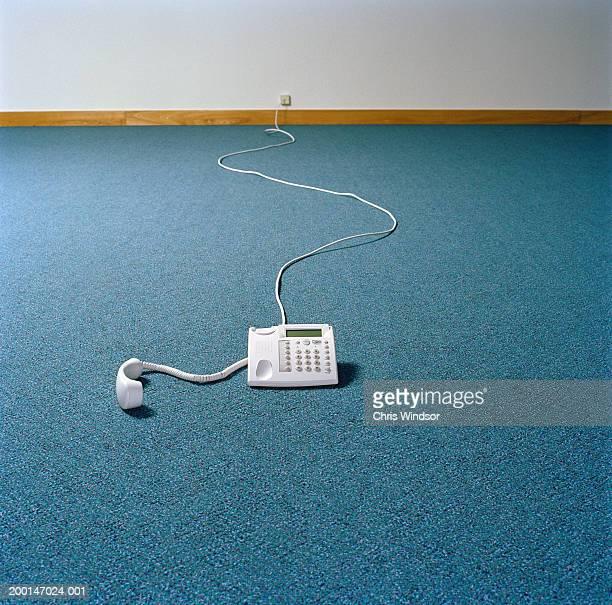Telephone on floor of empty room
