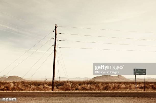 Telephone Pole and Road Sign in Desert Landscape, Arizona, USA