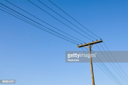 Telephone Pole and telephone lines in the blue sky