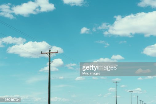 Telephone poles, power lines and cloudy sky, near Quincy, USA