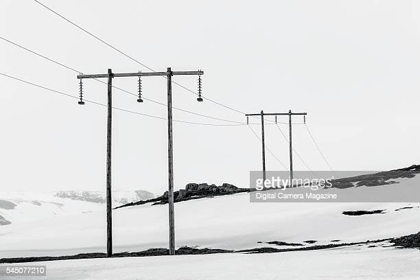 Telephone poles stretching across a mountainous landscape in Iceland on October 11 2014