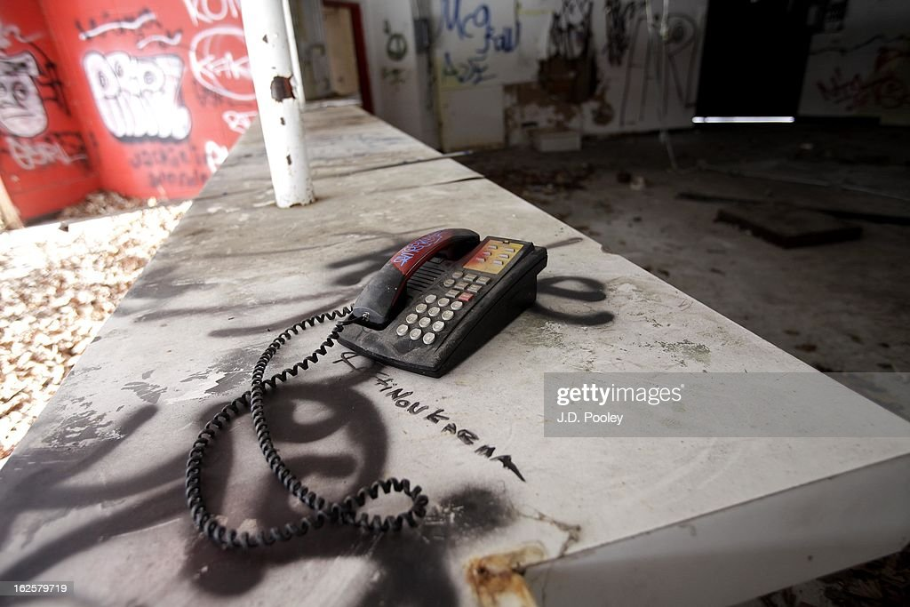 A telephone sits on a table at the former Belle Isle Safari Zoo February 24, 2013 in Detroit, Michigan. The city of Detroit has faced serious economic challenges in the past decade, with a shrinking population and tax base while trying to maintain essential services. A financial review team issued a finding on February 19 identifying the city as being under a 'financial emergency.' Michigan Gov. Rick Snyder has 30 days from the report's issuance to officially declare a financial emergency, which could result in the governor appointing an emergency financial manager to oversee Detroit's municipal government.