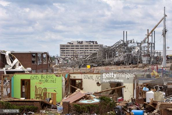 CONTENT] A telephoto shot near 2509 South Joplin Avenue in Joplin Missouri gives a sense of the scale of devastation after a tornado Is the distant...