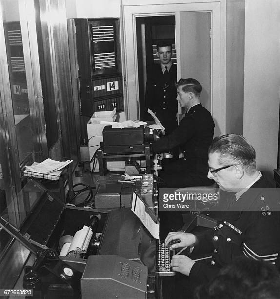Teleprinter operators at work in the Telegraph Office at the New Scotland Yard building on the Victoria Embankment by the Thames at Westminster...