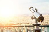 Telescope on top of high building in Paris.