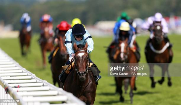 Telescope ridden by Ryan Moore on their way to victory in the Hardwicke Stakes during Day Five of the 2014 Royal Ascot Meeting at Ascot Racecourse...