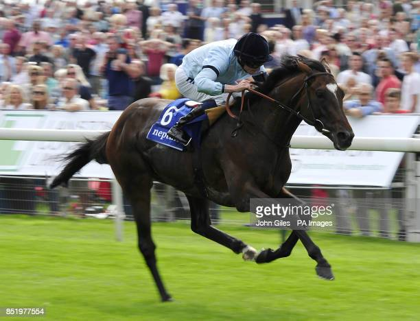 Telescope ridden by Ryan Moore win the Neptune Investment Management Great Voltigeur Stakes during day one of the 2013 Yorkshire Ebor Festival at...