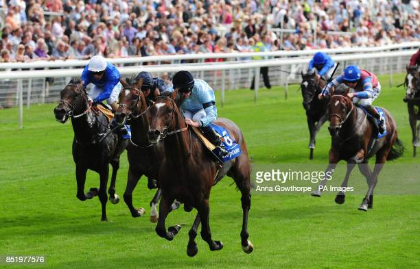 Telescope ridden by Ryan Moore wins the Neptune Investment Management Great Voltigeur Stakes during day one of the 2013 Yorkshire Ebor Festival at...