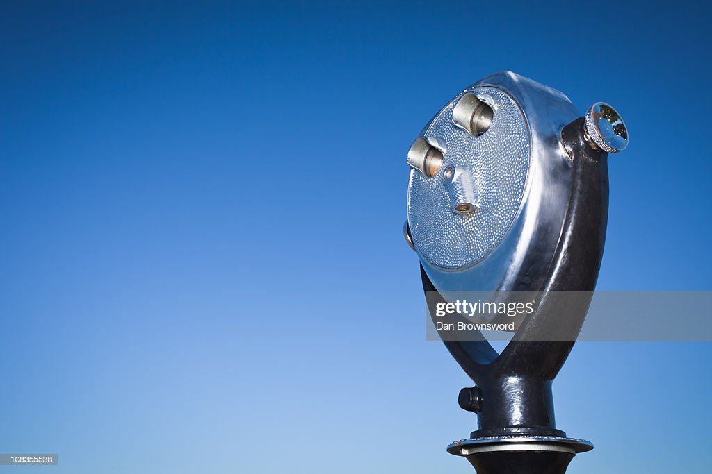 Telescopic viewer against blue sky