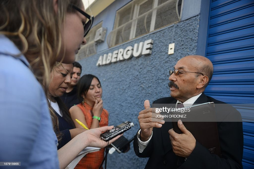 Telesforo Guerra (R), defence counsel of U.S. internet security pioneer John McAfee, speaks with journalists on December 7, 2012, in front of the detention center where McAfee is under custody, in Guatemala City. Mr Guerra said his client was feeling better a day after he was transferred to a hospital. Guatemala refused Thursday to grant asylum to US anti-virus software pioneer John McAfee and said he would be deported back to Belize to answer questions over his neighbor's murder. Shortly after learning his fate, McAfee was rushed to a police hospital from his jail cell in Guatemala City, with one lawyer saying he had suffered two mild heart attacks and another describing 'heart problems' and chest pains. AFP PHOTO Johan ORDONEZ