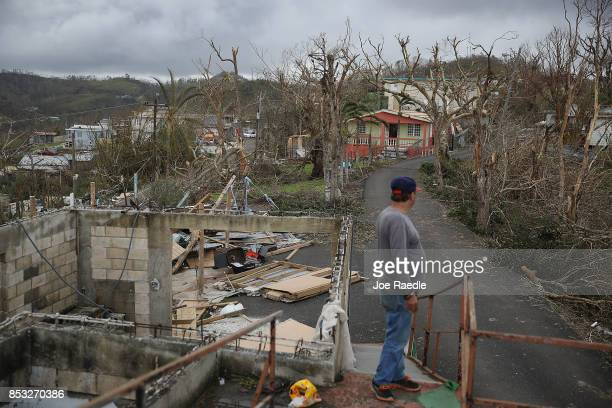 Telesforo Menendez surveys the damage in his neighborhood September 24 2017 in Hayales de Coamo Puerto Rico Puerto Rico experienced widespread damage...