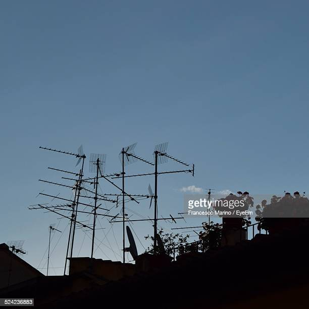 Television Aerials Against Sky At Dusk
