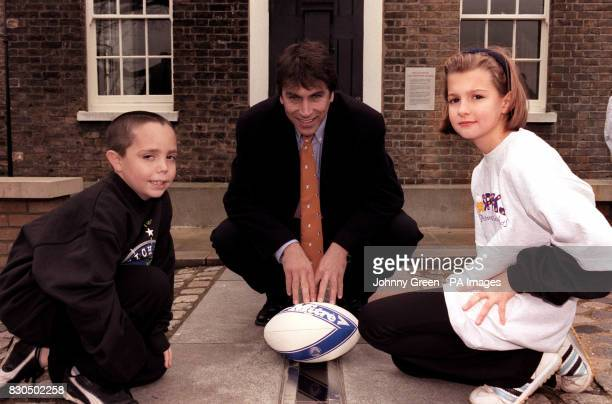 Television and radio presenter John Inverdale joins youngsters from the Meridian Primary School Greenwich on the Meridian Line at the Royal...