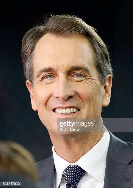 Television announcer Cris Collinsworth watches the Houston Texans warm up before the Texans play the New England Patriots on December 13 2015 at NRG...