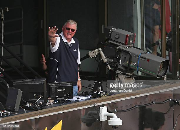 Television announcer Ken 'Hawk' Harrelson of the Chicago White Sox leads fans in singing 'Take Me Out to the Ball Game' during the 7th inning stretch...