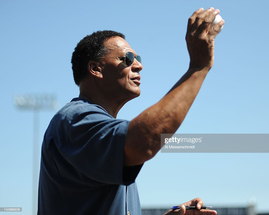 Television announcer Ken Singleton stretches for an autograph ball before the New York Yankees host the New York Mets in a spring training game April 4, 2012 at George M. Steinbrenner Field in Tampa, Florida.