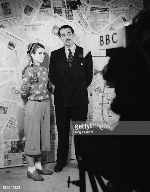 BBC television announcer Leslie Mitchell interviewing 'fashion compere' Vivian Pickles for the show 'Teenage' at the Alexandra Palace London December...