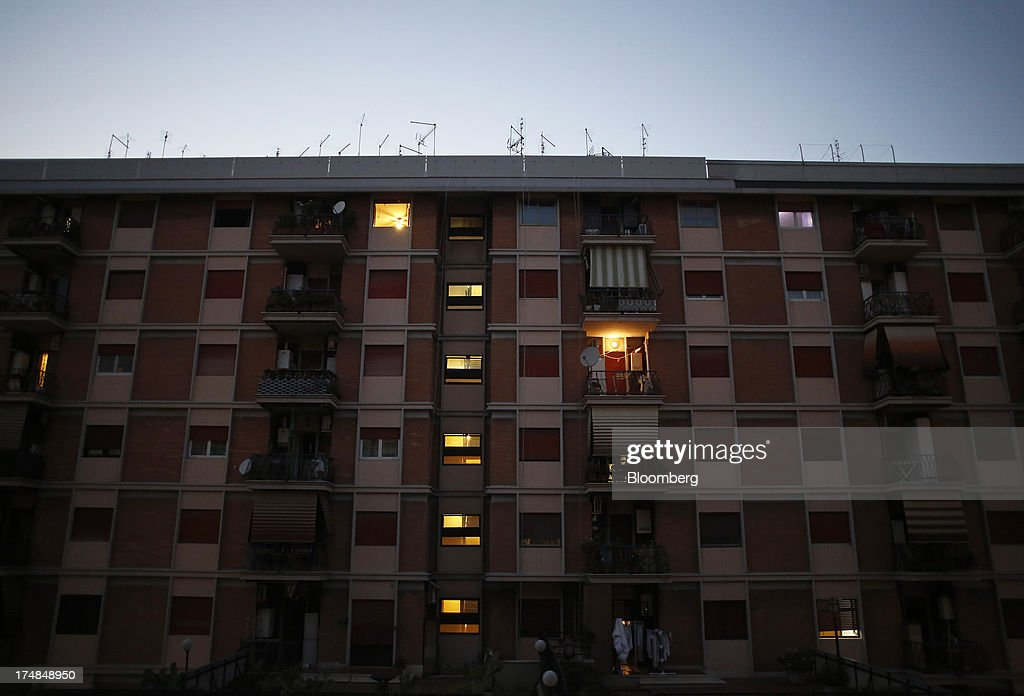 Television antennas sit on top of a residential apartment building at dusk in central Rome, Italy, on Saturday, July 27, 2013. Italy's home prices are low enough to trigger an increase in purchases for the first time since 2006, though that won't lift values for at least two years, according to the Nomisma institute. Photographer: Alessia Pierdomenico/Bloomberg via Getty Images