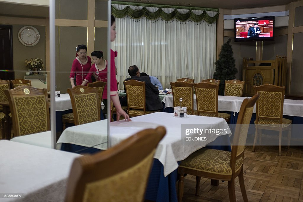 A television broadcast showing a speech by North Korean leader Kim Jong-Un at the 7th Workers Party Congress is displayed at a restaurant at the Yanggakdo hotel in Pyongyang on May 6, 2016. North Korea kicked off its first ruling party congress for nearly 40 years Friday, with state media lauding the isolated country's 'prestige' as a nuclear power while maintaining a news blackout on the event itself. / AFP / Ed Jones