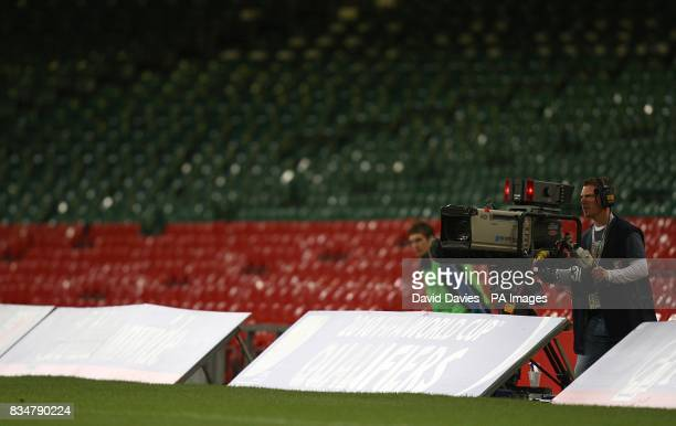 A Television camera films the action while seats lie empty behind