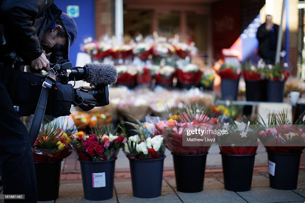 A television camera man films a flower stall on market day on Valentine's Day in the town centre on February 14, 2013 in Eastleigh, Hampshire. A by-election has been called in the constituency of Eastleigh after it's former MP, Chris Huhne, resigned after pleading guilty to perverting the course of justice over claims his ex-wife took speeding points for him in 2003.