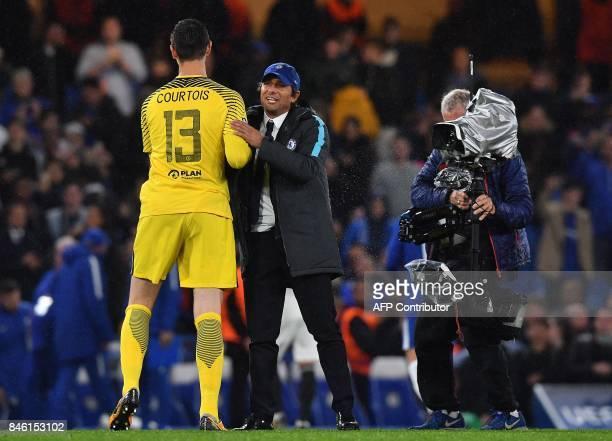 A television camera operator films as Chelsea's Italian head coach Antonio Conte congratulates Chelsea's Belgian goalkeeper Thibaut Courtois after...