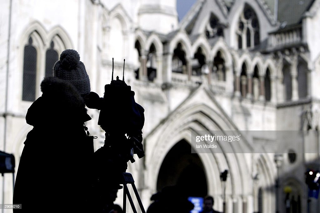 A television camera operator waits for Lord Hutton to arrive at the Royal Courts of Justice to reveal the contents of his report into the death of...