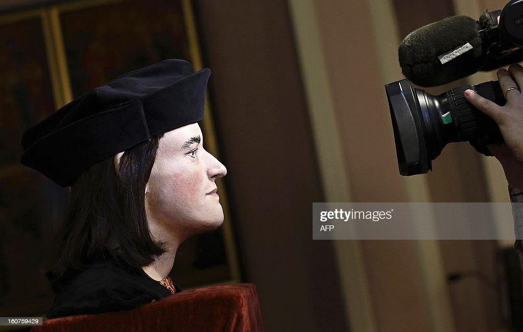 A television cameraman films a plastic facial model made from the recently discovered skull of England's King Richard III, during a press conference in London, on February 5, 2013. The face of England's King Richard III was revealed for the first time in more than 500 years on Tuesday following a reconstruction of his skeleton found underneath a carpark.