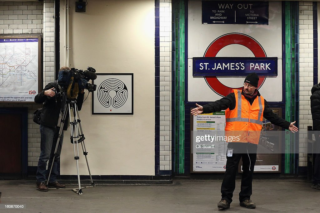 A television cameraman films artwork by Mark Wallinger on the platform of St James's Park Station as part of London Underground's largest ever art commission on February 7, 2013 in London, England. Mr Wallinger has been commissioned to produce artworks in all 270 stations on the Underground network to celebrate the 150 year anniversary of the tube opening.