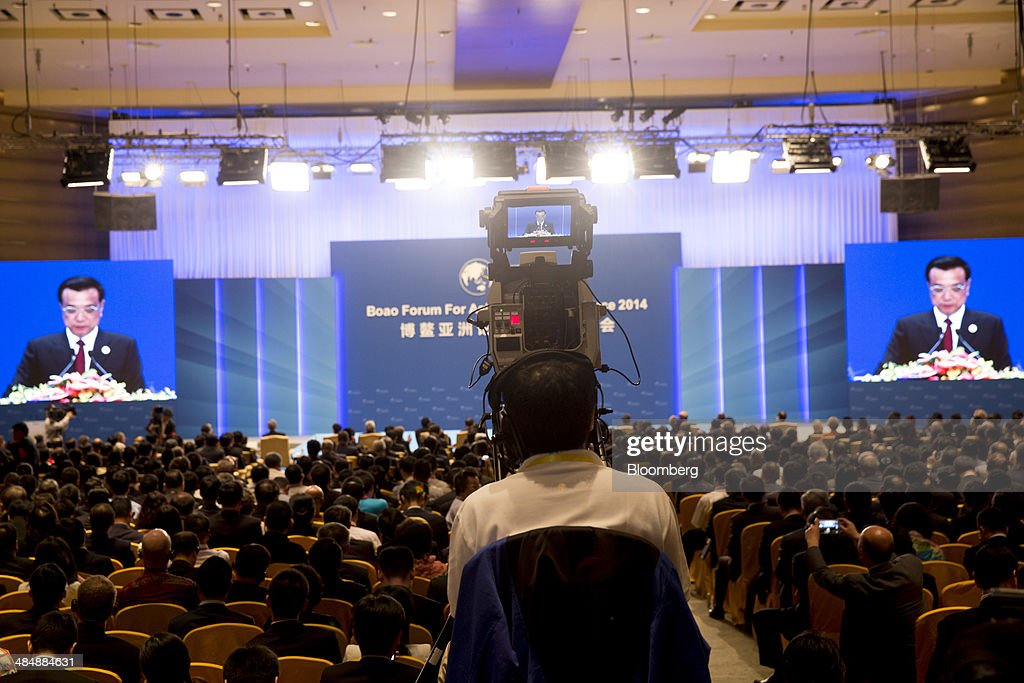 A television cameraman films <a gi-track='captionPersonalityLinkClicked' href=/galleries/search?phrase=Li+Keqiang&family=editorial&specificpeople=2481781 ng-click='$event.stopPropagation()'>Li Keqiang</a>, China's premier, as he delivers a speech at the Boao Forum for Asia in Boao, Hainan, China, on Thursday, April 10, 2014. Li said China plans to connect the stock exchanges of Hong Kong and Shanghai as part of efforts to expand the nationÕs capital markets. Photographer: Brent Lewin/Bloomberg via Getty Images
