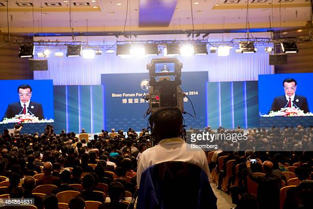 A television cameraman films Li Keqiang China's premier as he delivers a speech at the Boao Forum for Asia in Boao Hainan China on Thursday April 10...
