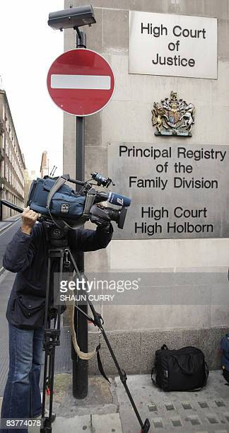 A television cameraman films outside the Family Division of London's High Court in central London on November 21 2008 A British judge granted pop...