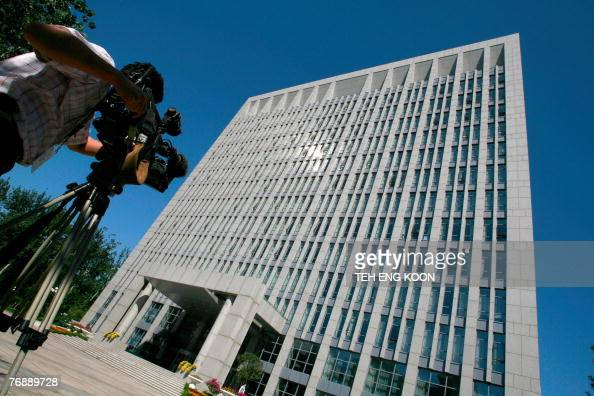 A television cameraman films the building of the Central Commission for Discipline Inspection of the Chinese Communist Party's key internal...