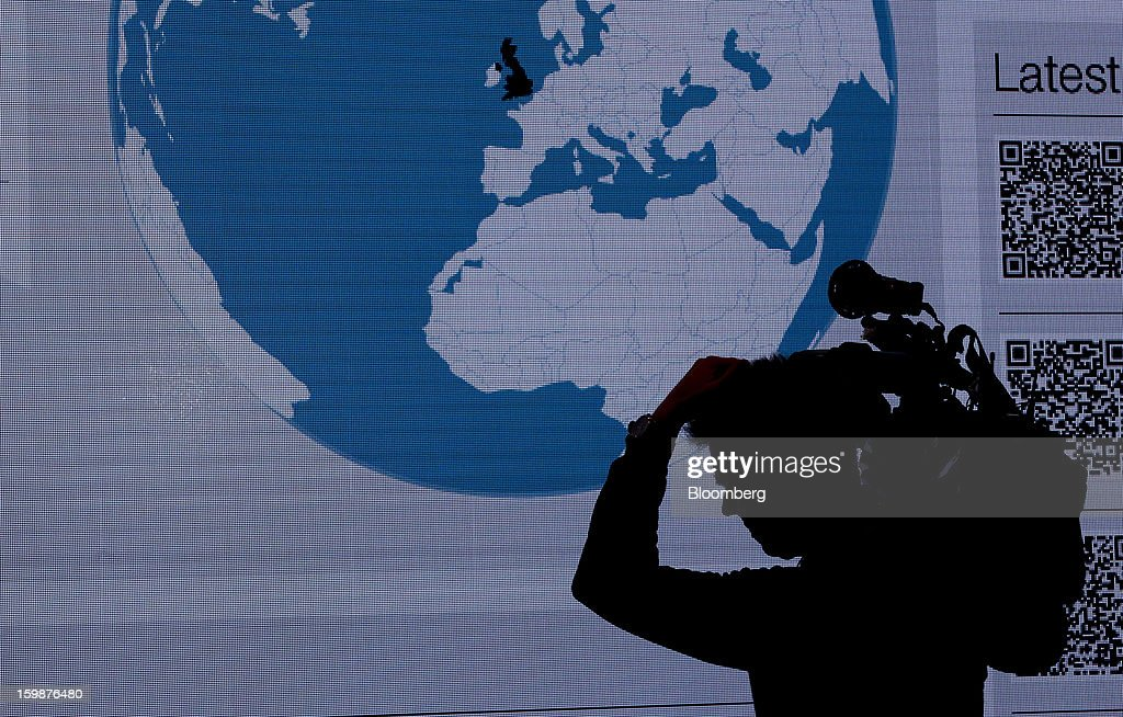 A television cameraman is seen silhouetted against a video screen inside the Congress Center, the venue for the WEF meeting in Davos, Switzerland, on Tuesday, Jan. 22, 2013. World leaders, Influential executives, bankers and policy makers arrive in the Swiss Alps for the 43rd annual meeting of the World Economic Forum in Davos, the five day event runs from Jan. 23-27. Photographer: Jason Alden/Bloomberg via Getty Images
