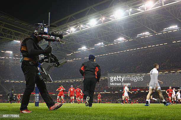 A television cameraman keeps a close eye on play during the RBS Six Nations match between Wales and England at the Millennium Stadium on February 6...