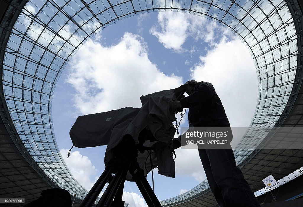 A television cameraman prepares for the 2009 IAAF Athletics World Championships at the Olympic Stadium in Berlin on August 13, 2009, two days before the opening of the event. The World Championships are taking place in Berlin from August 15 to August 23, 2009.