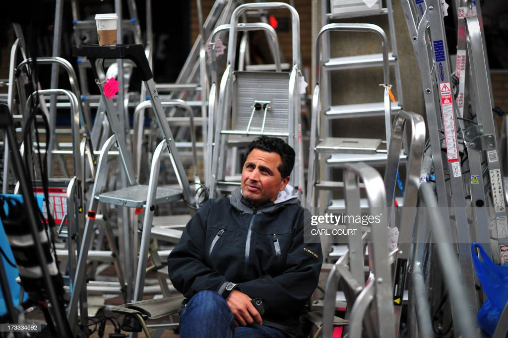 A television cameraman waits amongst stepladders outside the Lindo Wing of Saint Mary's Hospital in London, on July 12, 2013. Prince William and his wife Catherine's baby, which will be third in line to the throne, will be born in the private Lindo wing of St Mary's Hospital, where William was born in 1982 and his brother Harry in 1984.