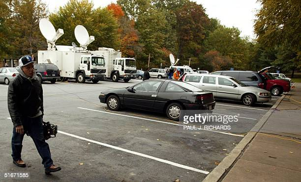 A television cameraman walks next to the parking spot at a rest stop on interstate 70 about 11 miles West of Frederick Maryland near Myersville...